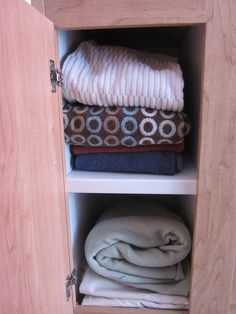 Day 13: After: bottom cupboard. I moved some sheets that belong in another room to that room and tidied up the rest. @Becky_ Organizing Made Fun™ #spontaneousorganizing