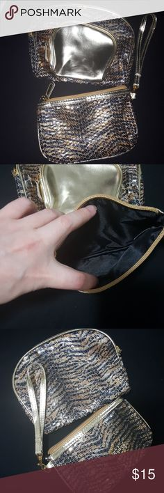 Sequin tiger print wristlet and clutches Gold and black sequin tiger print 3 piece set. None have ever been used. Zipper closures. Bags Clutches & Wristlets