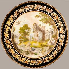 A GOOD ITALIAN CENTRE TABLE OF THE IMPERO PERIOD. THE TOP ALMOST CERTAINLY PIETRO DELLA VALLE, Italian, Circa 1825 Dimensions: H: 32.5 in / 82 cm Dia: 36 in / 91 cm