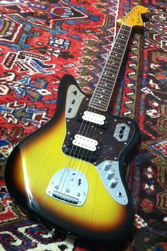 Fender Japan Kurt Cobain Jaguar with added Black Gotoh Bridge. Nirvana. They stocked this guitar with a smaller tune-o-matic chrome bridge. Also 2 of the volume/tone knobs are 1 meg pots. The last is 250. I found that interesting. Why not all 3? The Mexico version did use 1 meg for all 3 pots as Kurt did with his pre-made lucky find Jaguar.