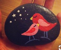 Cute red birds painted rock