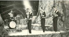 """Postkort The Spotnicks brukt 1965 - The Spotnicksare aninstrumental rockgroupfromSweden, who were formed in 1961. Together with the Shadows and the Ventures they are counted as one of the most famous instrumental bands during the 1960s. They were famous for wearing """"space suit"""" costumes onstage, and for their innovative electronic guitar sound. They have released 42albums, selling more than 18 million records, and still tour."""