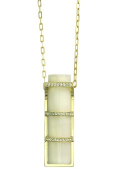 """Streamline Pan-Pacific Pendant- 18k yellow gold and diamonds inlayed in Organic Vegatable Ivory on 18k yellow oval link chain 18""""."""