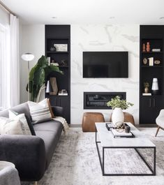 neutral modern living room with marble fireplace, black and white living room decor, Leclair Decor ( Living Room Modern, Home Living Room, Interior Design Living Room, Black Sofa Living Room Decor, Modern Room Decor, Black And White Living Room Ideas, Living Room White Walls, Cool Living Room Ideas, Interior Livingroom