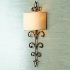 Hammered Bronze Iron Wall Sconce  http://www.shadesoflight.com/hammered-bronze-iron-wall-sconce.html