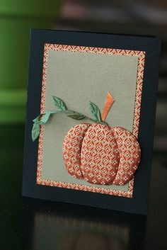 handmade card ... clean and simple design ... pumpkin done in Japanese Paper Quilting ... luv the washi paper from Hanko Designs ... black card base ... washi mat of same paper as pumpkin ... kraft main panel ... puffy quilted pumpkin on top of it all ... great card!!!