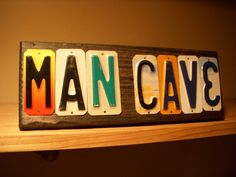 MAN CAVE sign made with license plates by CraftyPlates. My most popular sign. Can also read BOY CAVE or MAN ROOM.