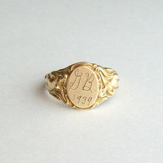 I love this 1930's signet ring with ladies flanking the sides. It's cheeky and shabby in all the right ways.