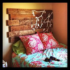 A gorgeous example of upcycled wood used as a headboard. As always, I'm a sucker for nature-y stenciling :)