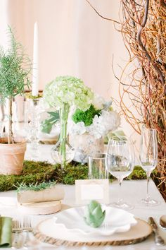 woodsy green and white wedding - photo by Laura Witherow Photography http://ruffledblog.com/a-midsummer-daydream-editorial #tables #tablescape #weddingideas