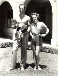 "Errol Flynn and Olivia de Havilland on the set of ""Captain Blood"", 1935"