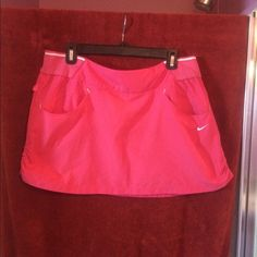 """Nike Dri-Fit Mini Skirt Nike Dri-Fit Women Skirt Size: Large  Color: Bright Pink Material:  Body: 100% Polyester Rib: 78% Cotton, 18% Polyester & 4% Spandex  (Exclusive of decoration) Style: Mini skirt ruched sides with pockets  Measurents:   Waist: 17"""" Hips: 18-1/2 Lenght: 13-1/2""""  GOOD CONDITION Come from a smoke/pet free home... Nike Skirts Mini"""
