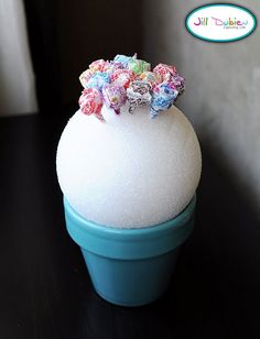 Fun idea. Dum dum lollipop tree....Try this with wrapped cake pops?