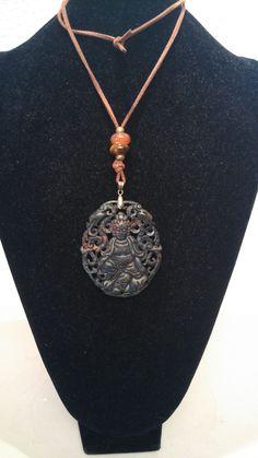 Medallón de piedra  marrón,con ante y piedras ojos de tigre
