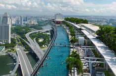 Marina Bay Sands Hotel in Singapore  has the worlds longest elevated pool that spans 3 towers (492' long) and sits on the edge of the 57th floor rooftop. If you don't want to swim you can ice skate on their indoor rink!