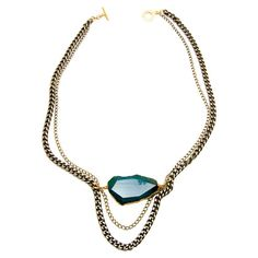 Stunning and sophisticated, this beautiful necklace features a slice of turquoise fire agate on an 18-karat gold-plated chain.  Prod...