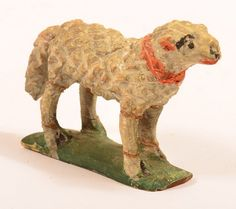 """Sold $750 Very Rare Carved and Painted Softwood Folk Art Lamb Figure Attributed to Wilhelm Schimmel. (Cumberland Valley, Pennsylvania 1817-1890). All original painted surface, orange collar with typical green platform base. Very few lamb examples are known to exist. 2-5/8""""h. x 4""""l. Condition: Old breaks to legs and tail with glue repairs. Totally complete and certainly worth having professionally restored if so desired."""