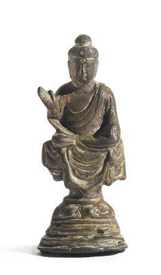 A SMALL BRONZE FIGURE OF BUDDHA - CHINA, TANG DYNASTY