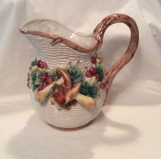 """Vintage 3-D Handpainted Mushroom Serving Pitcher OFF 1991 3 Qt Beautiful. The mushrooms are 3-D from the pitcher. The decorative mushrooms are 4"""" & 3"""" long. The pitcher holds 3 quarts. It stands 9 1/4"""" high x 10"""" across from spout to handle. The artwork is hand painted and the pitcher has a glaze dip.  A conversation piece for any kitchen or dining room.  This is a lovely rare piece. There are no chips.  Smoke free environment. Thanks for looking!  We are happy to ship worldwide."""