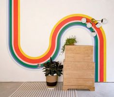 Modern brass sconce by Sazerac Stitches paired with a rainbow mural, light wood dresser and plants. Baby Boy Nursery Decor, Nursery Design, Light Wood Dresser, Wood Interior Design, Modern Interior, Sconces Living Room, Brass Sconce, Colorful Interiors, Rainbow
