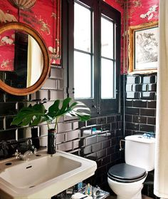 black trim and tile with red chinoiserie wallpaper