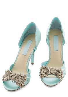 Betsey Johnson Dancing Gleam Heel in Crystal Blue. The big day is finally here, and your peep toes from Blue by Betsey Johnson fabulously lead the way as you strut into the venue! #gold #prom #modcloth