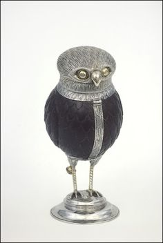 The Antwerp Owl Goblet (1548-1549). Silver and coconut.  This is the oldest known Antwerp owl goblet. The head of the owl could be screwed off, so people could drink from its body .  An old Dutch saying was engraved around the neck of the bird: 'Als alle ander fogels sin thoe neste sois min flige beste.' ('When all the birds are [lying] in their nests, my flight is best') - Decribing the owl as a bird who is active at night.