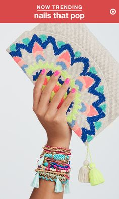 Summer calls for bold, fresh colors from fingertips to toes. Pair that new mani with bright accessories like a stack of brightly colored bangles and a vibrant clutch and consider yourself beach-ready.