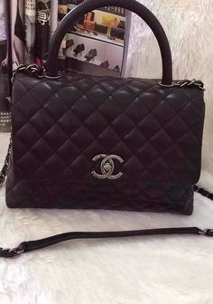 The Coco Handle Bag comes with a front flap ef508694a18dd