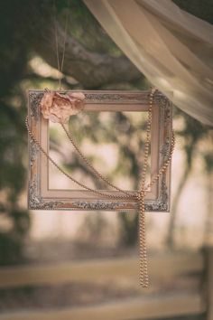 Old vintage picture frame with flower and pearls decor for a vintage wedding