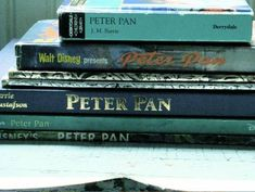 A collection of vintage Peter Pan story books... we have a similar stack of Alice in Wonderland editions.