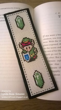 LoZ bookmark featuring link and green rupees available at etsy.com/uk/shop/lyndascraftroom