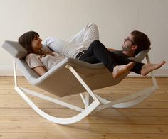 In this two-person rocker.   Community Post: 44 Amazing Places You Wish You Could Nap Right Now