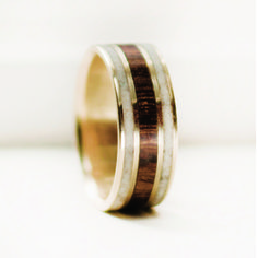 10k gold wedding band featuring wood and antler inlays, handmade just for you.