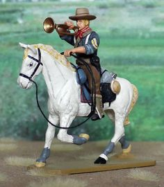 Spanish American War 1898 RR01M Mounted Rough Rider Trooper with Bugle Matte Paint Version - Made by King and Country Military Miniatures and Models. Factory made, hand assembled, painted and boxed in a padded decorative box. Excellent gift for the enthusiast.