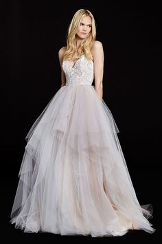Beautiful blush color pop in this tulle ball gown wedding dress by Hayley Paige, Fall 2015