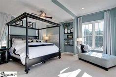 Beautiful bedroom! Black furniture,  blue gray walls