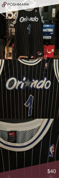 Nike Orlando Magic Tracy McGrady NBA Jersey Nike Orlando Magic Tracy McGrady VINTAGE RETRO NBA Jersey Size:XXL in excellent condition some minor fading on the logo and number but no rips, no stains, no damage at all All items being sold are guaranteed 110% authentic, genuine, and real product. No fakes no replicas NEVER!! trusted and reliable seller on multiple sites for over 10+ years.thank you very much for all inquiries enjoy your shopping experience. Nike Shirts