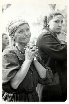 Close-up portrait of a praying Polish woman in besieged Warsaw. 1939. Julien Bryan.