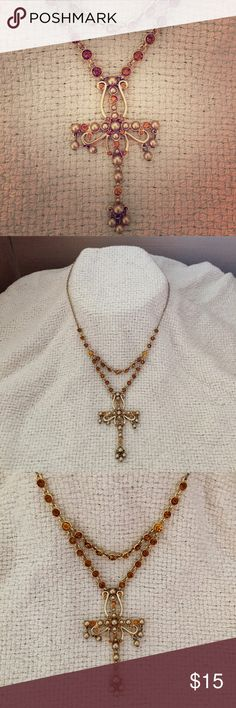 Avon cross necklace Avon necklace with a beautiful gold cross with gold beads and amber colored gemstones.  Worn maybe once or twice.  Looks brand new! Avon Jewelry Necklaces