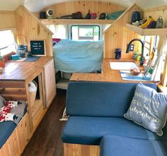 Cozy interior of a school bus conversion. I love all of the seating space and it's a low budget build!