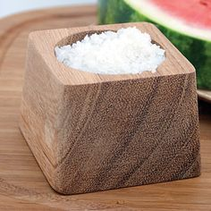 Square wood pinch bowl  http://www.celticseasalt.com/Acacia-Wood-Salt-Pinch-Bowl-P4971C41.aspx