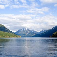 The Olympic Mountains and Crescent Lake    This glacially-carved lake, hidden among the northern foothills of the Olympic Mountains, offers plenty of day activities and stunning natural beauty. Its waters present clear views almost 60 feet deep.