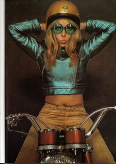 1970s bad girl motorcycle jacket electric metallic aqua blue tan jeans sunglasses sparkle helmet photo print ad model magazine vintage fashion style