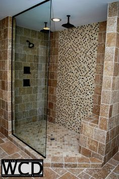 Travertine and Glass shower.  Designed and installed by Wilson Concepts & Design.