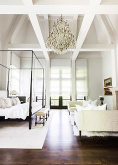 Grand bedroom design with four poster bed and elegant chandelier | Chad James Group