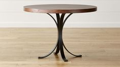Cobre Round Iron Bistro Table with Copper Top | Crate and Barrel (for an eat-in kitchen)