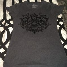 So cute tee Dark gray with black felty fleur de Lis on front and wings on back! Stranded Tops Tees - Short Sleeve