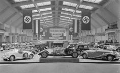 A look at the viewing gallery for the 1936 Berlin Auto Show, which was held within the heart of the Reich from February 15th to March 1st,1936. It boasted a wide variety of the latest and greatest automobile innovations from varying automobile companies of the German Reich, including big names like BMW and Mercedes-Benz. British vehicles were also put on display, particularly by the auto manufacturer 'Austin'.
