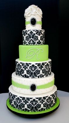 Six tier fondant cake with icing damask pattern, quilted fondant pattern, handmade edible jewels and monogram with a sugar rose cake top